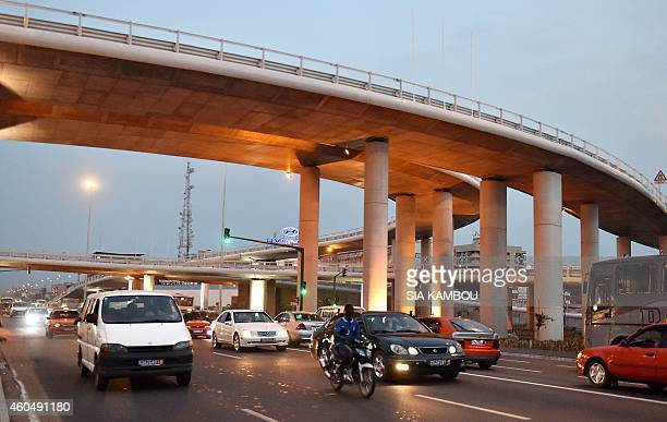 A picture taken on December 14 2014 shows cars driving under the Henri Konan Bedie bridge on the Valery Giscard d'Estaing Boulevard ahead of its...