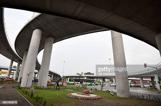 A picture taken on December 14 2014 shows the Henri Konan Bedie bridge over the Valery Giscard d'Estaing Boulevard ahead of its inauguration on...
