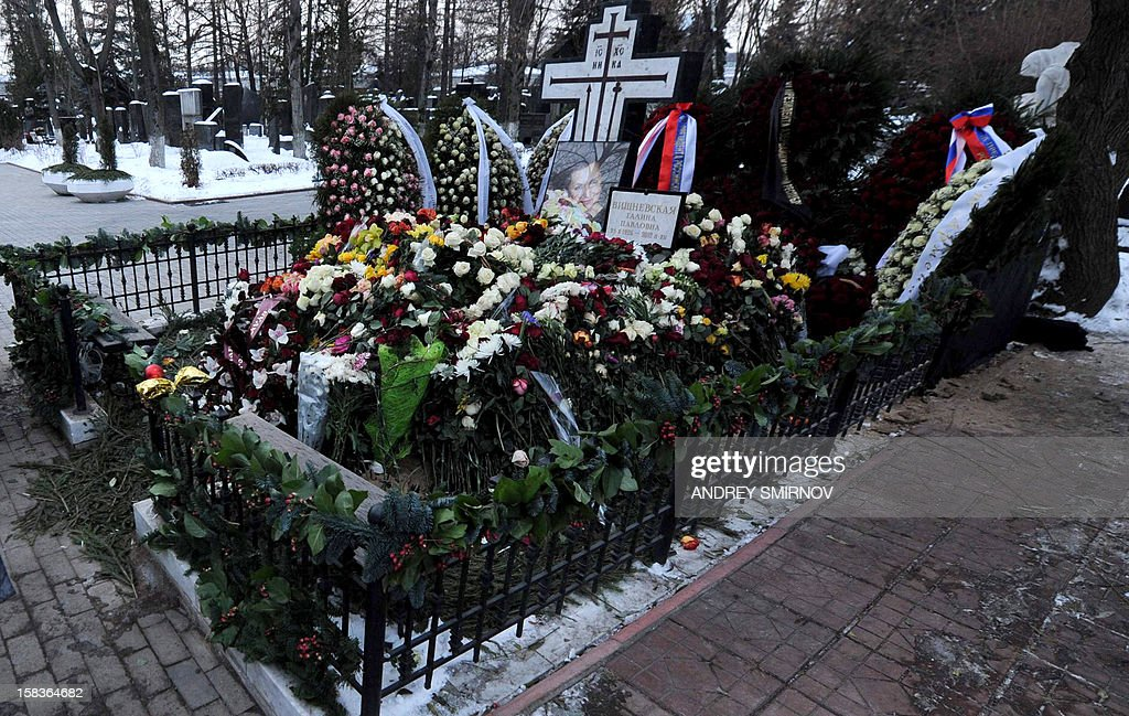 A picture taken on December 14, 2012, shows the grave of Russian opera star Galina Vishnevskaya at Novodevichy cemetery in Moscow, shortly after the soprano's funeral. Vishnevskaya, the widow of legendary cellist Mstislav Rostropovich, was buried today alongside her husband in the cemetery, which is the resting place of many famous Russians including writer Anton Chekhov and Soviet leader Nikita Khrushchev, the RIA Novosti state news agency said. AFP PHOTO / ANDREY SMIRNOV