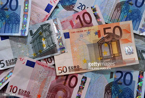 A picture taken on December 15 2011 in the northern city of Lille shows banknotes of 5 20 and 50 Euros International Monetary Fund chief Christine...