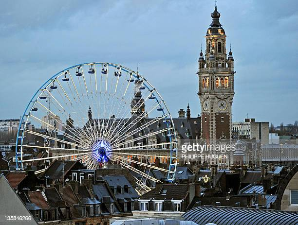 A picture taken on December 15 2011 shows a christmas tree and a big wheel set on the Grand Place in Lille northern France AFP PHOTO PHILIPPE HUGUEN