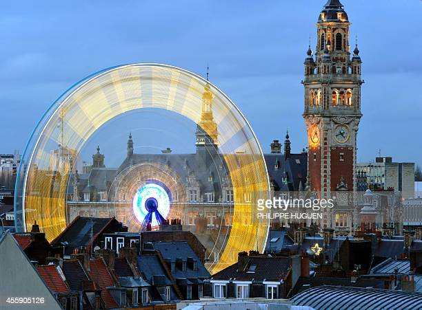 A picture taken on December 15 2011 shows by night a christmas tree and a big wheel set on the Grand Place in Lille northern France AFP PHOTO...