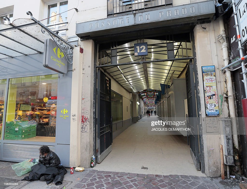 A picture taken on December 15, 2012 in Paris, shows an entrance of the 'Passage du Prado' (passageway), which leads to the faubourg Saint-Denis street. The Paris typical passages were built during the first half of the XIXth century. Covered by a glass structure and located on the Paris right bank area, near the Grands Boulevards they shelter shops and were created to protect customers from bad weather. Most of them disappeared during the Baron Haussmann renovation of Paris (1851-1870).
