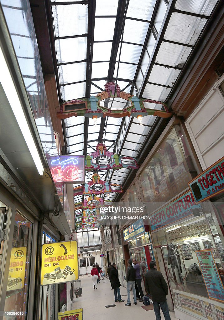 A picture taken on December 15, 2012 in Paris, shows the 'Passage du Prado' (passageway), which leads to the Saint-Denis boulevard. The Paris typical passages were built during the first half of the XIXth century. Covered by a glass structure and located on the Paris right bank area, near the Grands Boulevards they shelter shops and were created to protect customers from bad weather. Most of them disappeared during the Baron Haussmann renovation of Paris (1851-1870). AFP PHOTO/JACQUES DEMARTHON