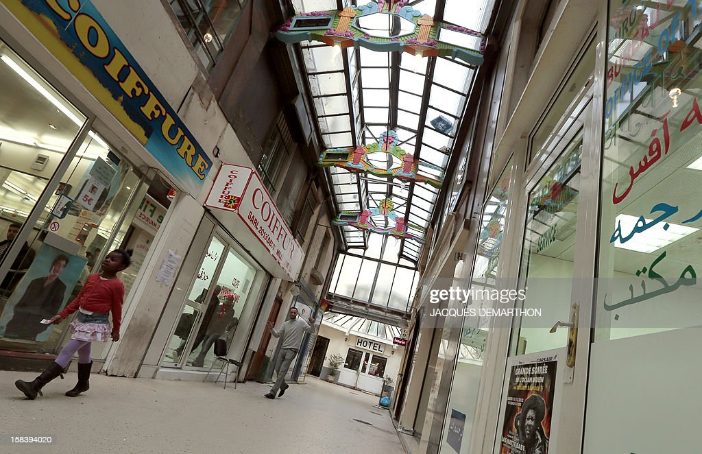 A picture taken on December 15, 2012 in Paris, shows the 'Passage du Prado' (passageway), which leads to the Saint-Denis boulevard. The Paris typical passages were built during the first half of the XIXth century. Covered by a glass structure and located on the Paris right bank area, near the Grands Boulevards they shelter shops and were created to protect customers from bad weather. Most of them disappeared during the Baron Haussmann renovation of Paris (1851-1870).