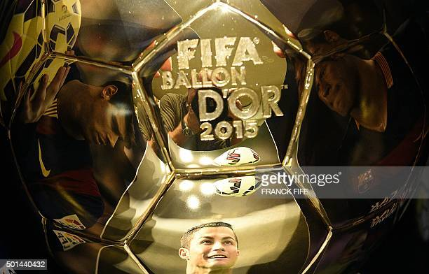 A picture taken on December 15 2015 shows images of Barcelona's Brazilian forward Neymar Real Madrid's Portuguese forward Cristiano Ronaldo and...
