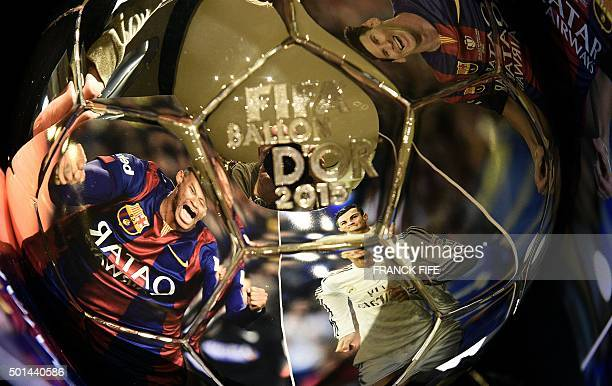 TOPSHOT A picture taken on December 15 2015 shows images of Barcelona's Brazilian forward Neymar Real Madrid's Portuguese forward Cristiano Ronaldo...