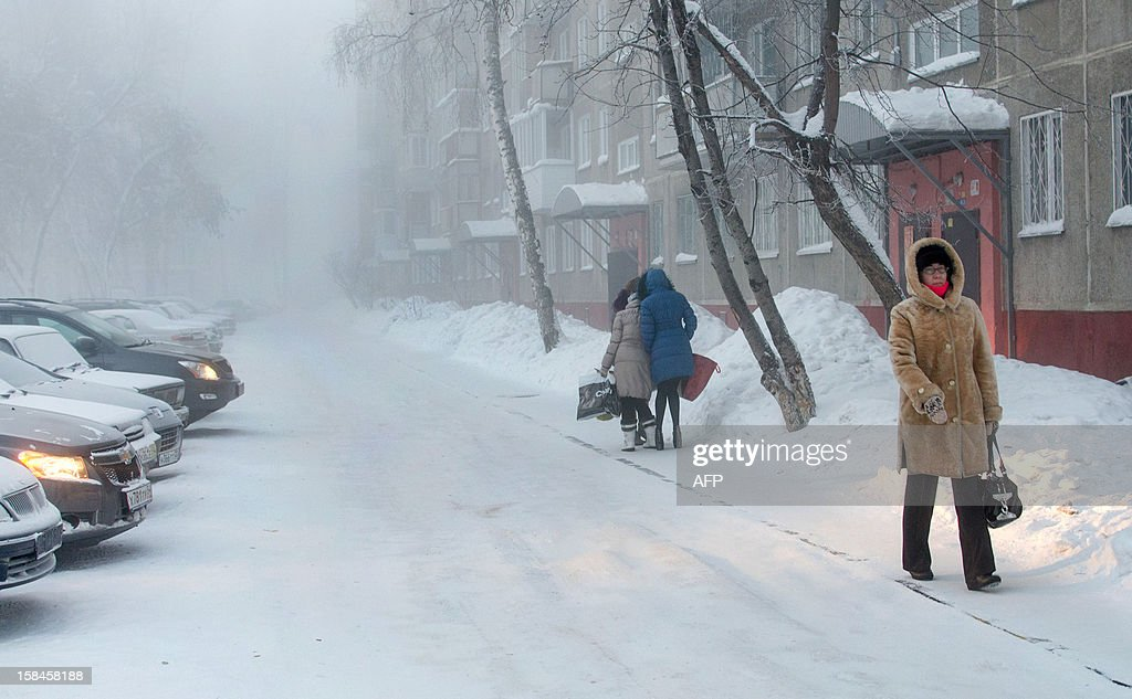 A picture taken on December 15 shows people braving the abnormally freezing outdoors in the Siberian city of Novosibirsk about 2800 km east of Moscow...