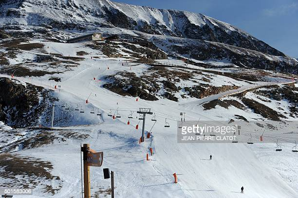 A picture taken on December 16 2015 shows snowy ski trails at 2100 metres in the French ski resort of L'Alpe d'Huez in Central French Alps a few...