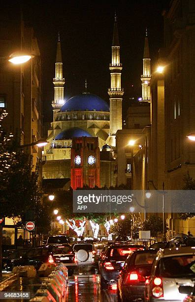 Picture taken on December 17 2009 shows bottleneck traffic on a rainy day in downtown Beirut with the parliament's clock tower and the landmark...
