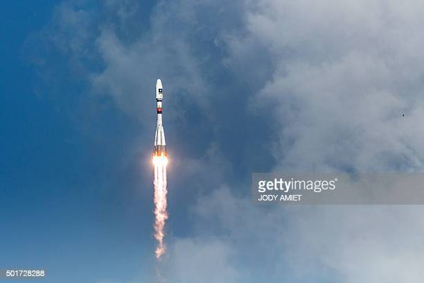 A picture taken on December 17 2015 shows a Soyuz rocket blasting off from the European space centre at Kourou French Guiana Europe was set to launch...