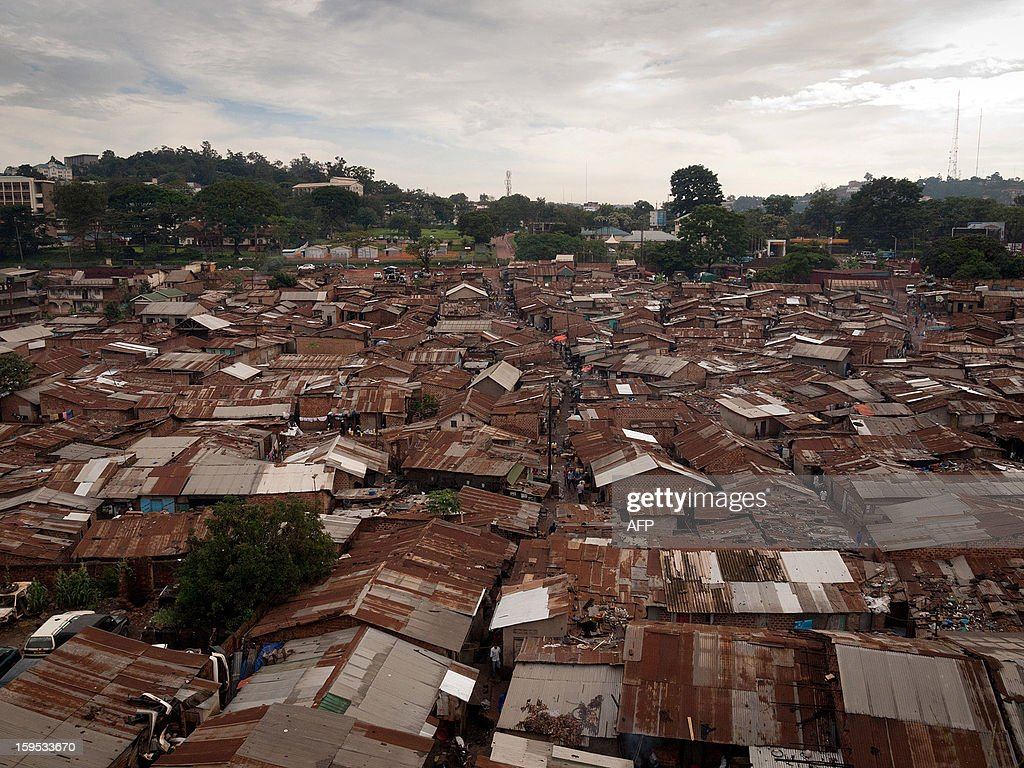 A picture taken on December 18, 2012 shows a general view of the Kataanga slum in the Ugandan capital, Kampala, where two sisters, both professional boxers, live and train. Helen Turyanabo, 23, along with her younger sister Diana, 20, living in a trash ridden slum area, are two young women who stand out amongst their neighbours as they both are professional boxers, literally trying to fight their way out of poverty. After a man tried to rape Helen, the older of the two sisters, it inspired her to learn how to fight inorder defend herself, and despite recently winning a medal in an East African Regional Championship, Helen and Diana still have to collect garbage to sell to get money for food for themselves and nearly 20 other people, cramped into two rooms with no water or electricity. AFP PHOTO/Michele Sibiloni.