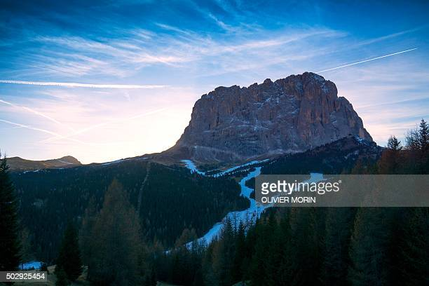 A picture taken on December 18 2015 in Santa Christina di val Gardena shows a slope covered with artificial snow at the foot of the Sassolungo or...