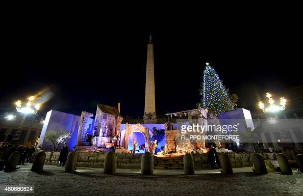 A picture taken on December 19 2014 at the Vatican shows the crib and the Christmas pine tree in front of Saint Peter's basilica after they were...