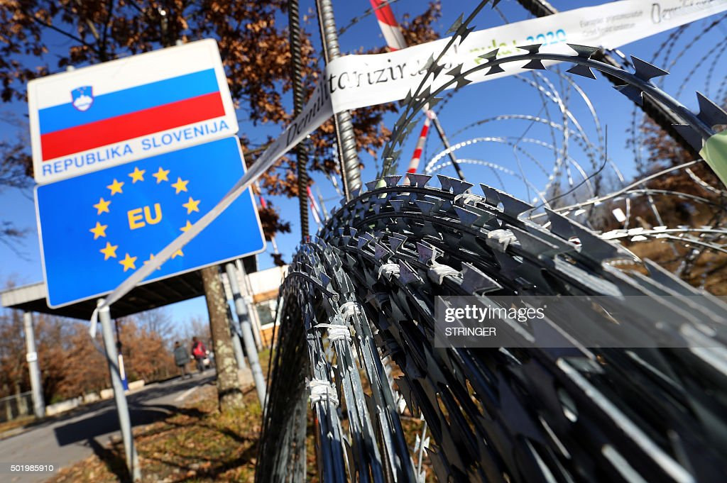 A picture taken on December 19 2015 shows a razorwire fence on the Lucija Brezovica border crossing rolled out by Slovenia on Croatia's border to...