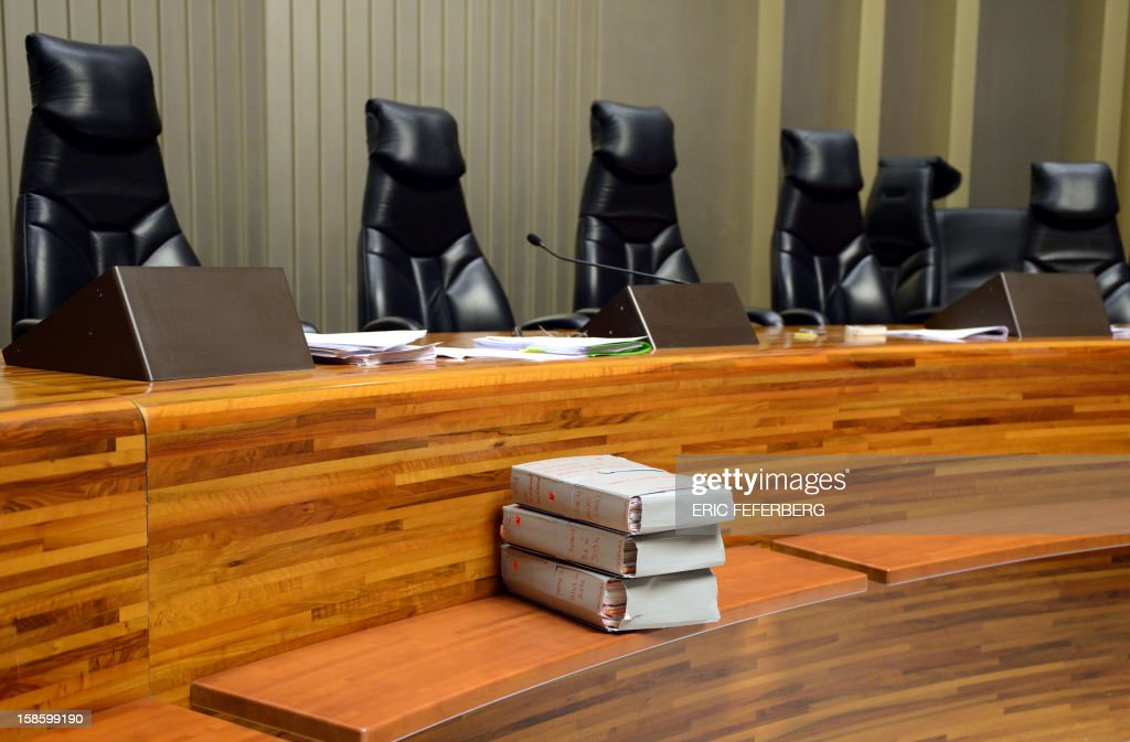 A picture taken on December 20, 2012 shows files (C) displayed in a courtroom at the criminal court in Creteil, a Paris suburb during the trial of Dieter Krombach, accused of the killing of his daughter Kalinka Bamberski, 30 years ago.The prosecution had requested 15 years of imprisonment against Krombach on October 21, 2011.