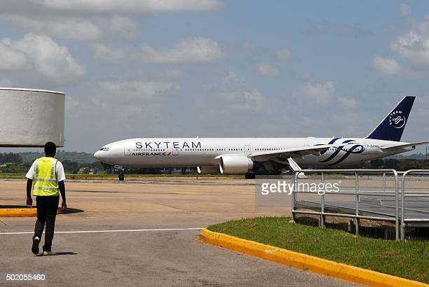 A picture taken on December 20 2015 shows an Air France flight from Mauritius to Paris grounded at the Moi International Airport in Mombasa after a...