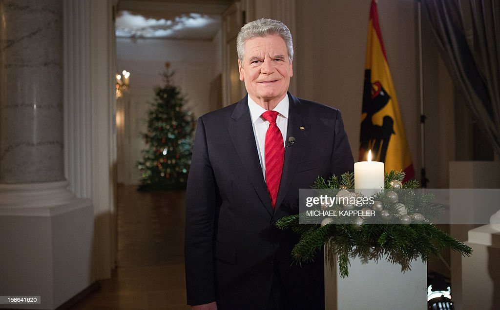 Picture taken on December 22, 2012 shows German President Joachim Gauck during the recording of his Christmas speech at Bellevue Palace, Berlin. AFP PHOTO / POOL / MICHAEL KAPPELER
