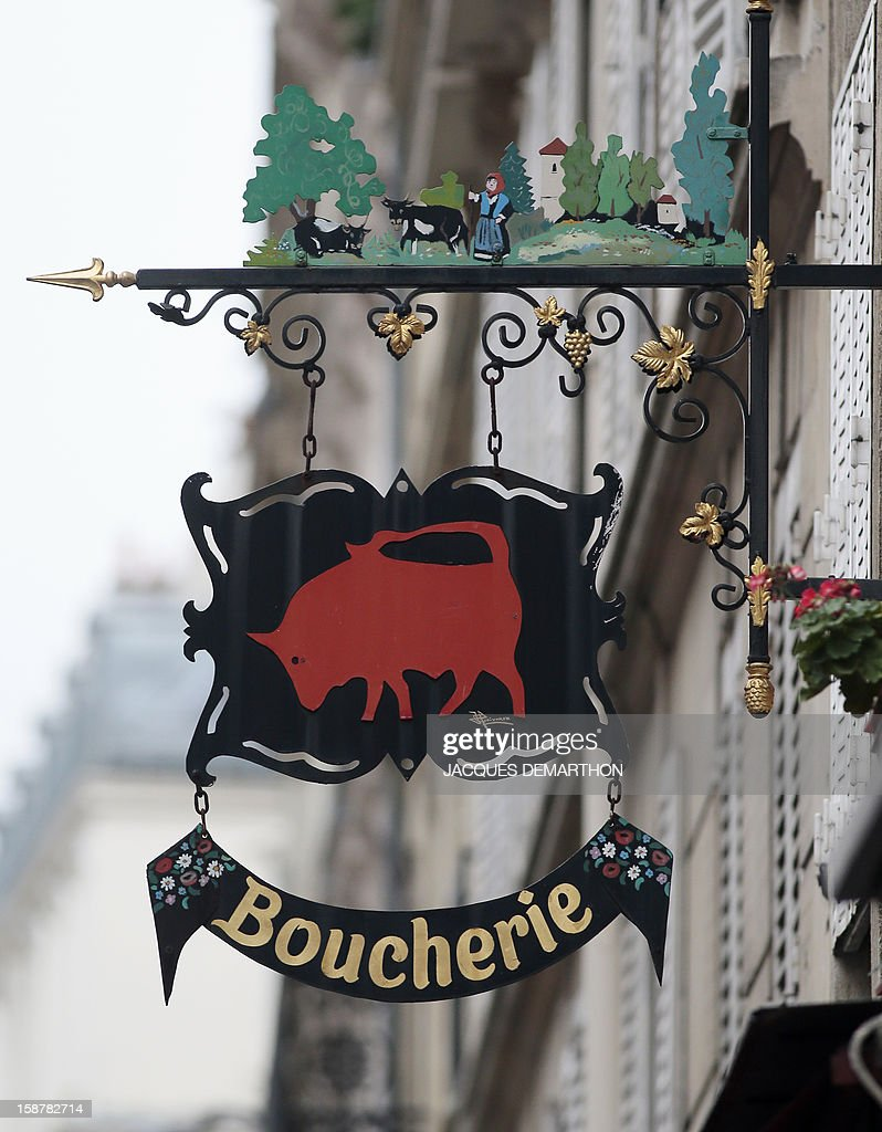 A picture taken on December 28, 2012 in Paris shows a butcher sign.