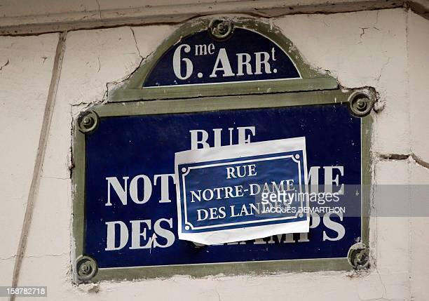 A picture taken on December 28 2012 in Paris shows a sticker reading 'Rue NotreDame des Landes' related to the NotreDame des Landes airport displayed...