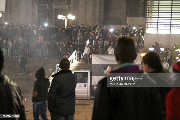 Picture taken on December 31 2015 shows people gathering in front of the main railway station in Cologne western Germany Police in Cologne told AFP...
