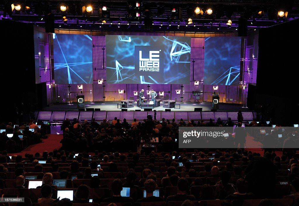 A picture taken on December 4, 2012 shows people in the audience using laptops during a session at LeWeb Paris 2012 in Saint-Denis, near Paris. AFP PHOTO ERIC PIERMONT