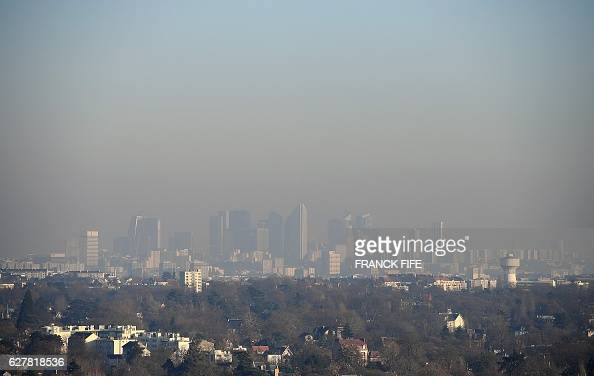 A picture taken on December 5 2016 from SaintGermainenLaye shows a view of La Defense business in a smog on December 5 2016 Pollution reaches a peak...