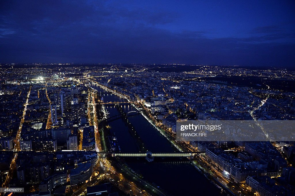 A picture taken on December 6, 2013 shows the river Seine and buildings at night in Paris.