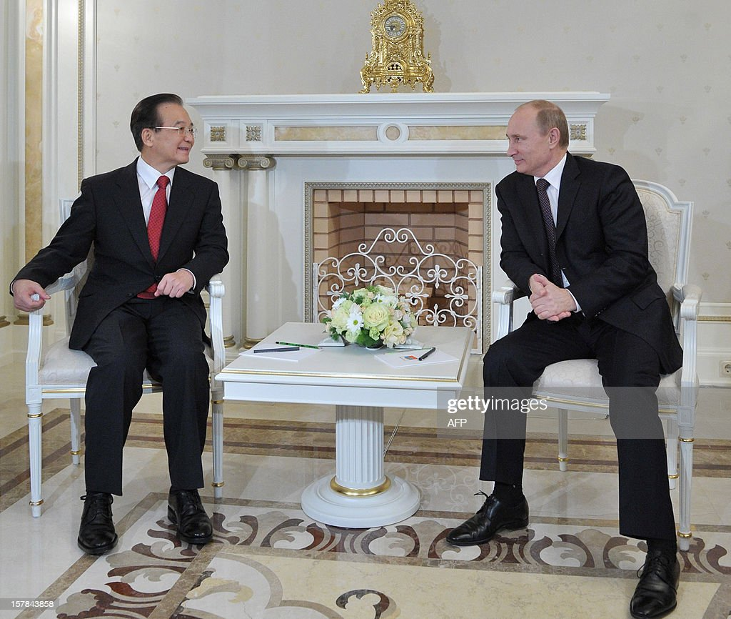 A picture taken on December 6, 2012, shows Russia's President Vladimir Putin (R) speaking with Chinese Prime Minister Wen Jiabao during their meeting in the Bocharov Ruchei residence in the Russian Black Sea resort of Sochi. Wen Jiabao is on a visit to Russia.