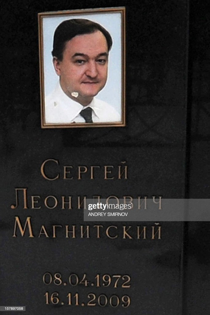 A picture taken on December 7, 2012, shows a close view of Russian lawyer Sergei Magnitsky's portrait with his name and the lifetime below on the lawyer's tomb at the Preobrazhenskoye cemetery in Moscow. The US Congress drew today a furious response from the Kremlin by passing legislation that targeted human rights abusers in the prison death of Magnitsky. Moscow immediately called the action 'a theater of the absurd' and vowed to retaliate, turning what would have been a boost in trade relations between the two powers into another source of friction.