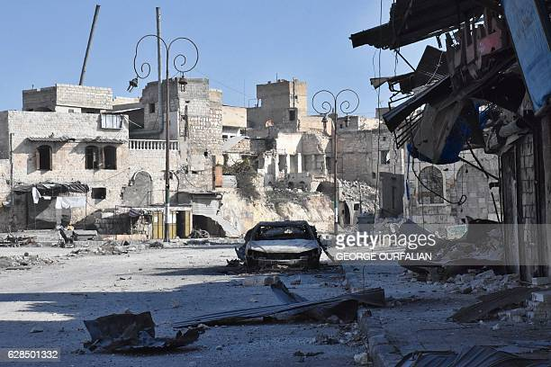 TOPSHOT A picture taken on December 8 shows destroyed buildings in the Bab alHadid neighbourhood in Aleppo's Old City after Syrian progovernment...