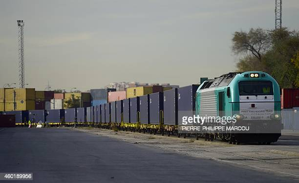 A picture taken on December 9 2014 shows the 'Yixin'ou' cargo train arriving at the Abronigal railway station in Madrid The 82wagon cargo train which...