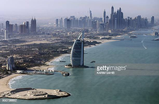 A picture taken on December 9 2015 shows a general view of the luxury Burj alArab Hotel at Jumeirah area in Dubai AFP PHOTO / POOL / KARIM SAHIB /...