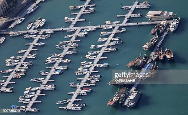 TOPSHOT A picture taken on December 9 2015 shows boats moored at the Marina neighbourhood in Dubai SAHIB