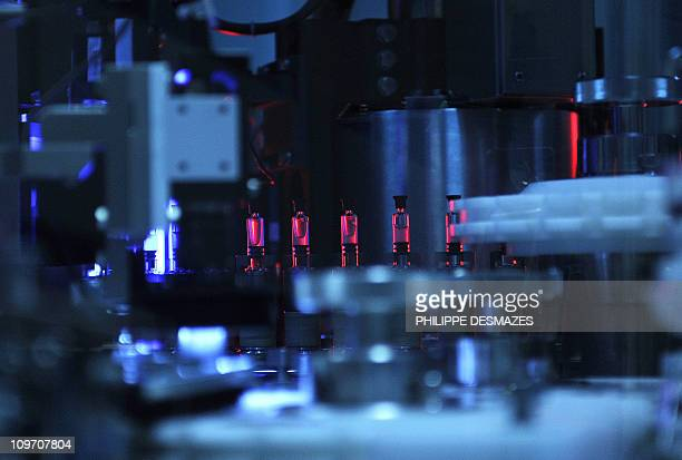 A picture taken on February 1 2011 shows a vaccine assembly line in the vaccine production factory of SanofiPasteur the vaccine branch of the French...