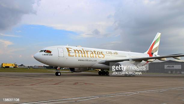 A picture taken on February 1 2012 shows an A330200 Airbus plane of Emirates airline at the Harare International Airport on February 1 2012 Emirates...