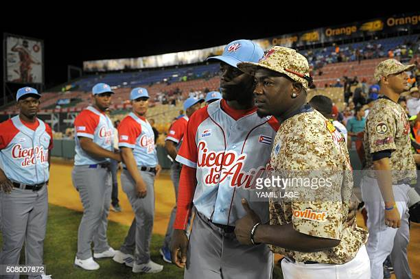 Picture taken on February 1 2016 showing Cuban baseball player Jose Adolis Garcia posing with his brother Adonis Garcia member of Venezuela's Tigres...