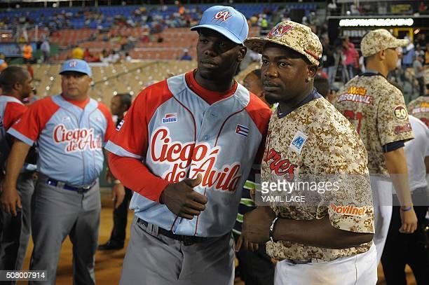 Picture taken on February 1 2016 showing Cuban baseball player Jose Adolis Garcia posing with his brother Adonis Garcia member of Venezuela's Tigres...