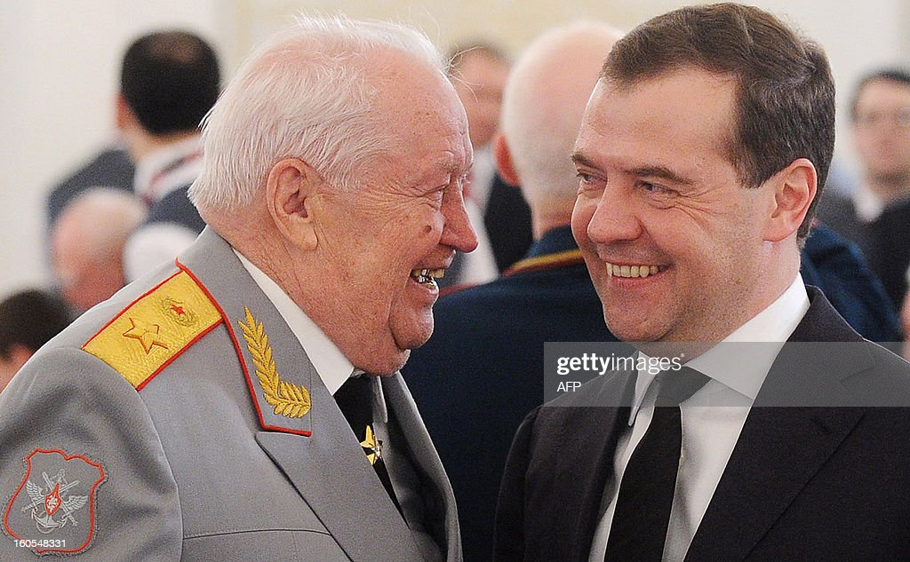 A picture taken on February 1, 2013, shows Russia's Prime Minister Dmitry Medvedev (R) sharing a joke with a World War II veteran at a reception marking the 70th anniversary of the Stalingrad Battle, in the Kremlin in Moscow.Russia marked today the 70th anniversary of a brutal battle in which the Red Army defeated Nazi forces and changed the course of World War II. AFP PHOTO/ RIA-NOVOSTI POOL/ ALEXEI NIKOLSKY