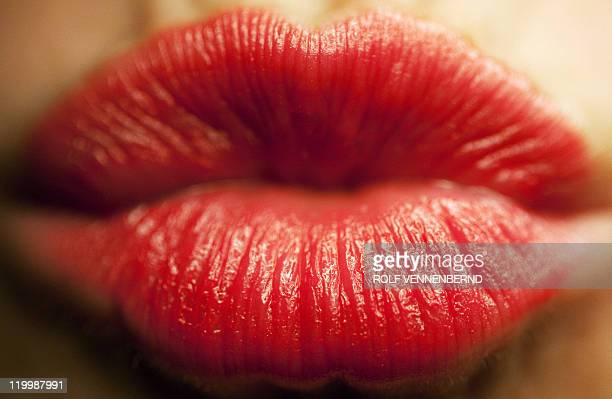 Picture taken on February 10 2011 shows lips covered with red lipstick forming a kiss On July 6 2011 is international kissing day AFP PHOTO / ROLF...