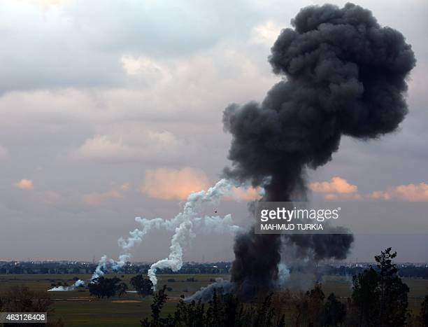 A picture taken on February 10 2015 in Tripoli shows smoke billowing after members of the Military College of Engineering of Misrata destroyed...