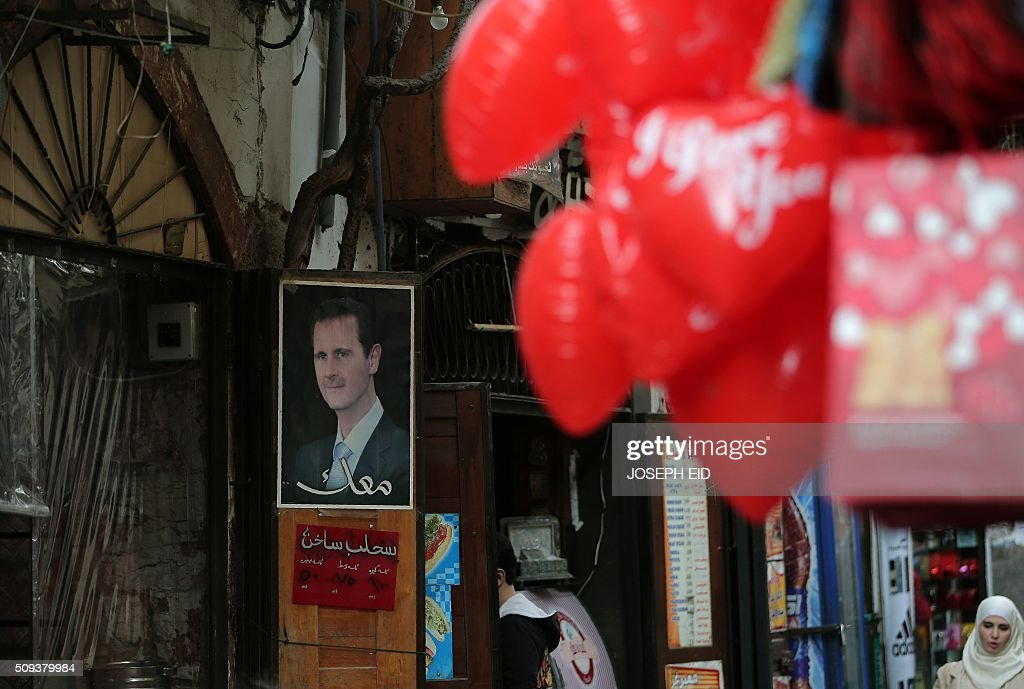 A picture taken on February 10, 2016 in Damascus shows a portrait of Syrian President Bashar al-Assad displayed outside a shop. / AFP / JOSEPH EID