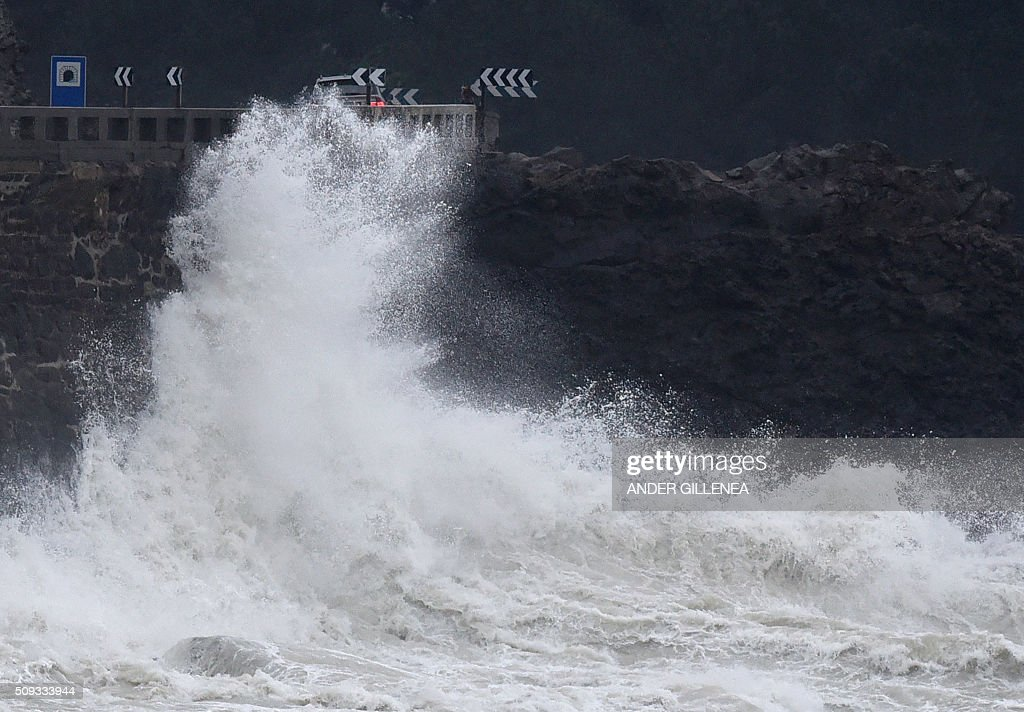 A picture taken on February 10, 2016 shows waves hitting a retaining wall in the northern Spanish village of Zumaia. Alerts have been issued for dangerous waves along the Basque coast. / AFP / ANDER GILLENEA