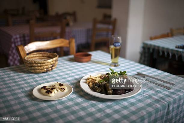 A picture taken on February 10 shows a traditional Cypriot dish made up of meatballs and halloumi at a restaurant in the unrecognized...