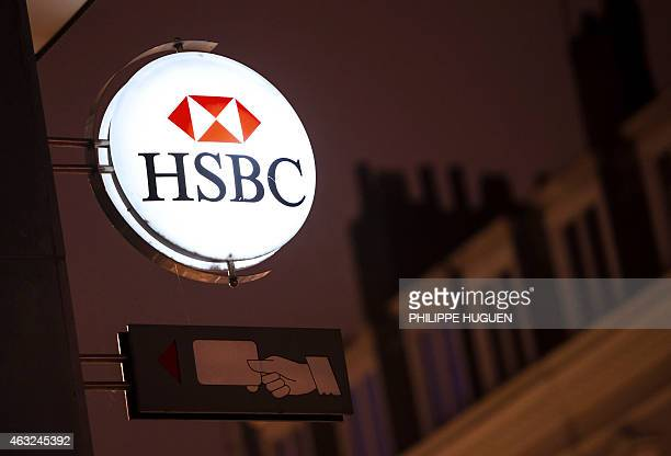 A picture taken on February 12 2015 in the northern France city of Lille shows the logo of banking giant HSBC on a sign of one of the bank's branch...