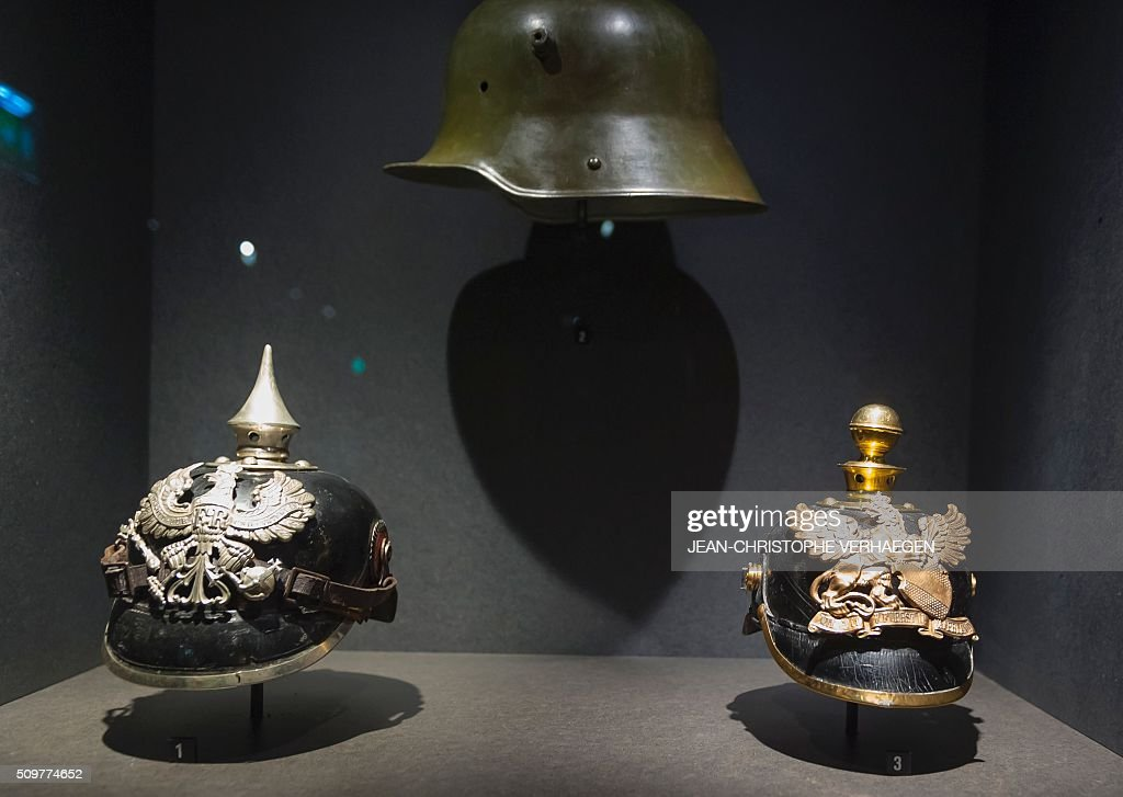 A picture taken on February 12, 2016 in Fleury-devant-Douaumont, eastern France shows helmets displayed for the exhibition in the redesigned Memorial of Verdun that commemorate the 1916 Battle of Verdun. The memorial will reopen on February 22, 2016. / AFP / JEAN-CHRISTOPHE VERHAEGEN