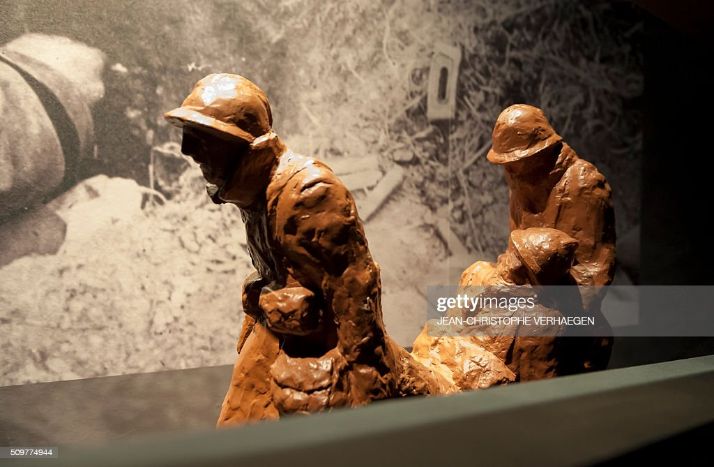A picture taken on February 12, 2016 in Fleury-devant-Douaumont, eastern France shows statues of soldiers displayed for the exhibition that commemorate the 1916 Battle of Verdun in the redesigned Memorial of Verdun. The memorial will reopen on February 22, 2016. VERHAEGEN