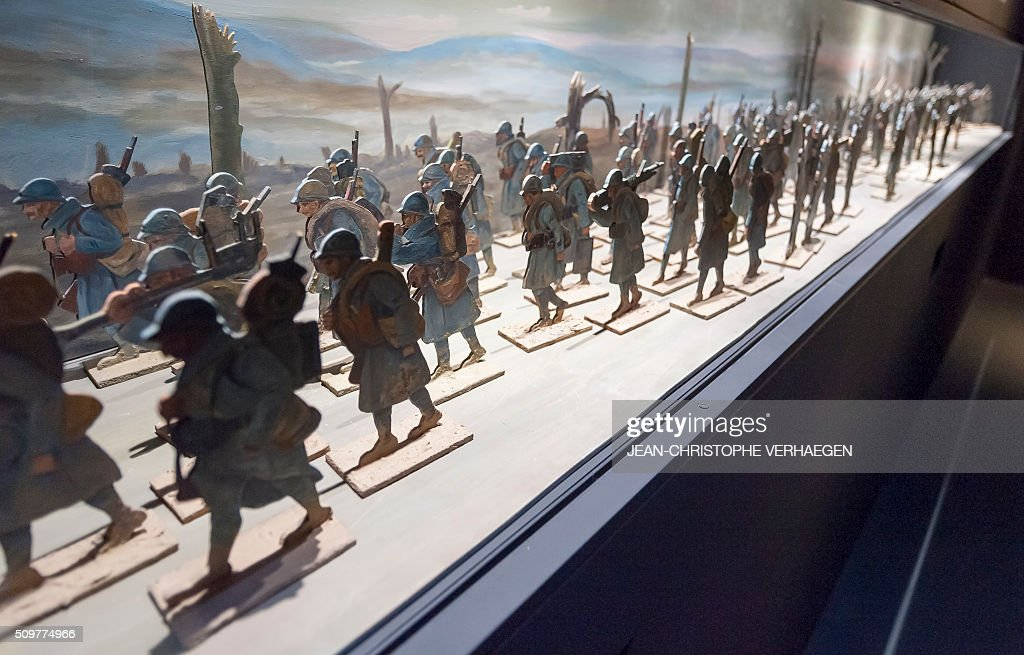 A picture taken on February 12, 2016 in Fleury-devant-Douaumont, eastern France shows figurines of soldiers displayed for the exhibition that commemorate the 1916 Battle of Verdun in the redesigned Memorial of Verdun. The memorial will reopen on February 22, 2016. VERHAEGEN