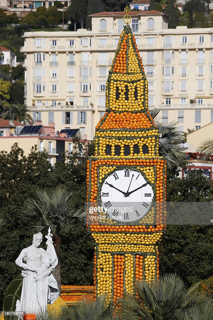 A picture taken on February 13, 2013 shows 'The rail road with Big Ben' a sculpture made of oranges and lemons, in Menton on the French Riviera, ahead of the start of the 'Fete du Citron' (lemon carnival). The theme of this 80th edition, running from February 16 until March 6, 2013, is 'Le Tour du monde en 80 jours' (80 days around the world). AFP PHOTO / VALERY HACHE