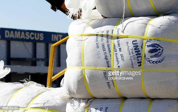 A picture taken on February 13 2014 at Damascus' International Airport shows parcels of emergency relief provided by the United Nation's Refugee...
